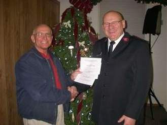 Dick Voakes presents checks to Don Karl